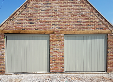 Two painted up and over garage doors