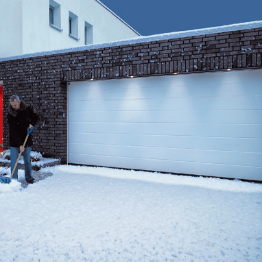 Insulating sectional garage door - snow