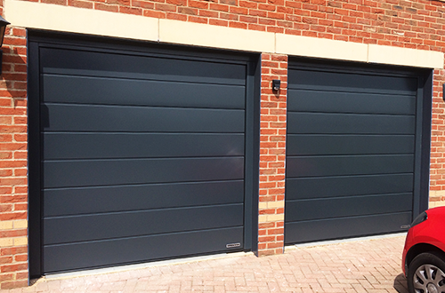 Pair of Single Width Hormann Sectional Garage Doors