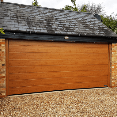 Woodgrain sectional garage door