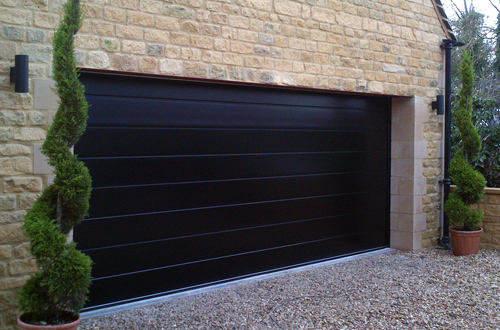 Carteck M-Ribbed Sectional Garage Door in Black