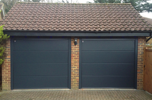 Pair of L-Ribbed Sectional Garage Doors by Carteck in Black