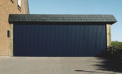 Large garage door in blue finish, aluminium slats