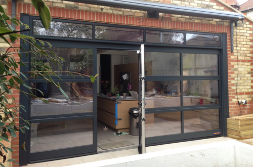 glass sectional door with pedestrian door inset