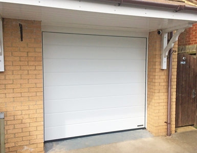 Double Skin Sectional Garage Door in White, Medium Ribbed Design