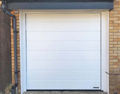 Insulated Sectional Garage Door with woodgrain finish