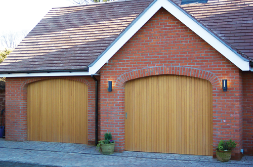 Side sliding timber garage door