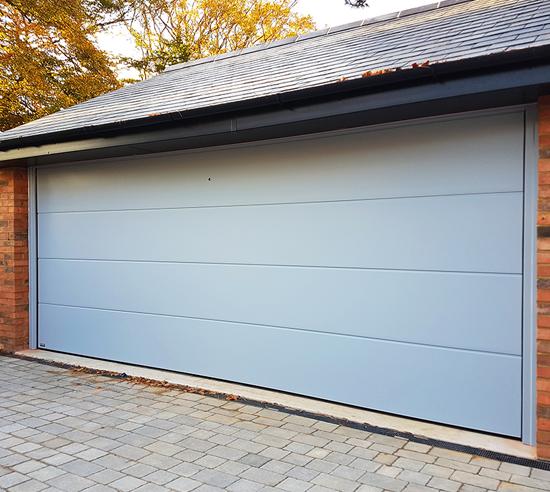 Sleek Carteck Sectional Garage Door