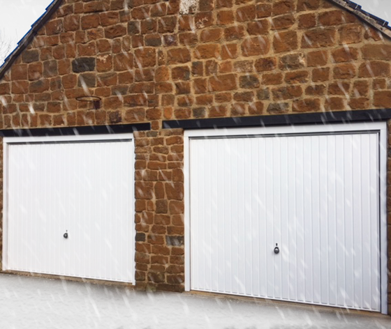 Installation of pair of White Up and Over Garage Doors