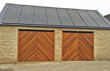 Two Single Up and Over Garage Doors in Chevron Design