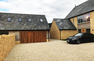 Woodrite Cedarwood Double Chalfont Up and Over Garage Door finished in Light Oak