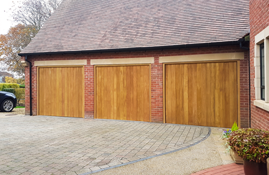 Woodrite Idigbo Up and Over Garage Door in Thames Design finished in Natural Oak