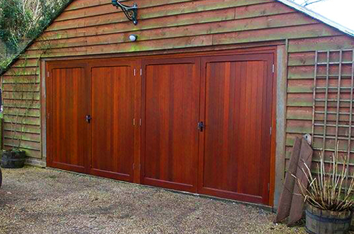 Side-hinged timber garage door