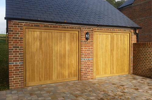 Pair of matching timber up and over garage doors