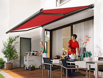 Markilux 990 patio awning in red over patio dining area