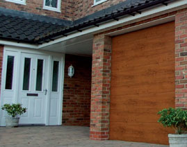 Gliderol Panel-Glide ribbed Tuscan with a timber planked style door