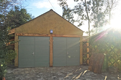 Insulated side hinged garage doors
