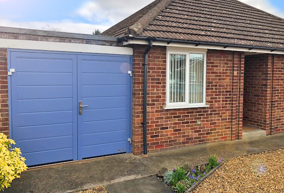 Hormann insulated side hinged garage door installation by The Garage Door Centre