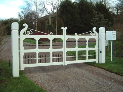 Pair of white painted timber estate gates with hydraulic ram automation