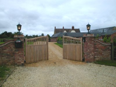 Pair of iroko timber automatic electric gates in Northamptonshire