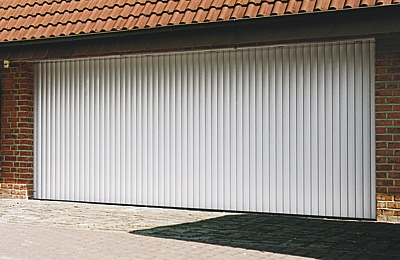 Vertico sliding garage door half open