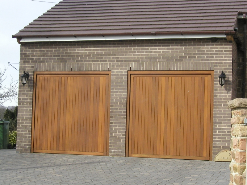 Cedar Bakewell Cedar wood timber doors installed inbetween openings on twin integral brick garage