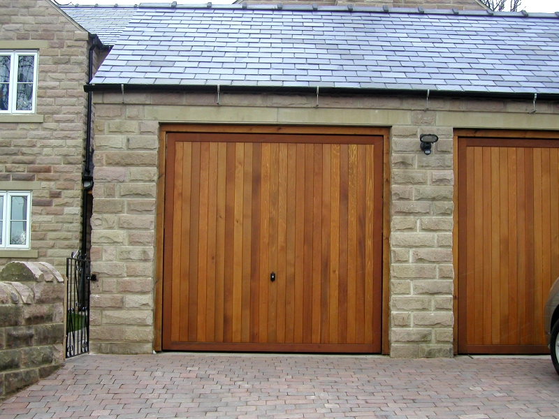 Cedar Bakewell Cedar wood timber doors installed inbetween openings on integral twin stone garage