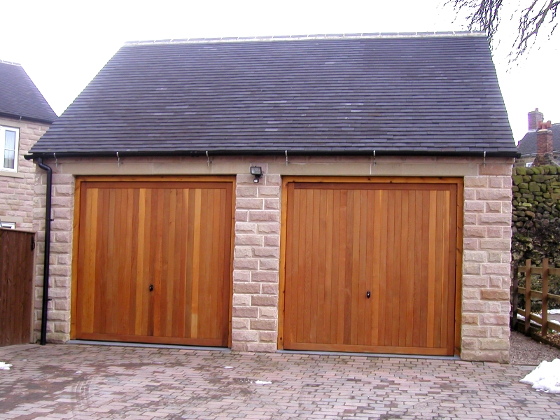 Cedar Bakewell Cedar wood timber doors installed inbetween openings on detached stone twin garage