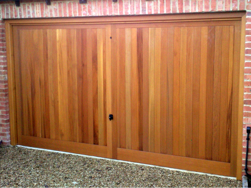 Cedar Heathersage Cedar wood timber door installed inbetween double brick integral garage
