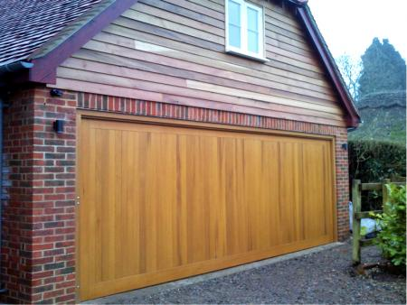Cedar Bakewell Cedar wood timber door installed inbetween double brick garage with cedar clad sub frame