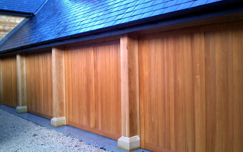 Woodrite Tingewick Cedar wood timber doors installed behind quadruple integral stone garage