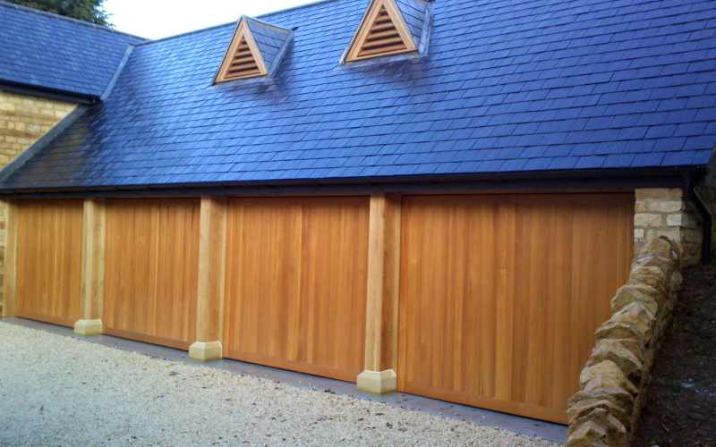 Woodrite Chalfont Cedar wood timber doors installed behind quadruple integral stone garage