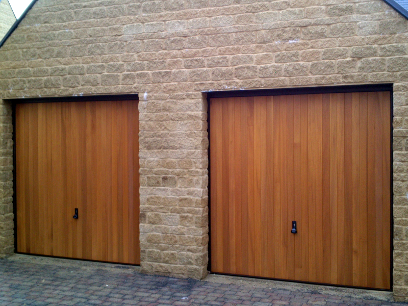 Woodrite Tingewick Cedar wood timber doors installed behind twin integral stone garage