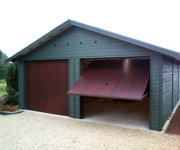 Hormann 2009 Vertical Cedar wood mahogany finish timber doors installed behind twin detached timber garage