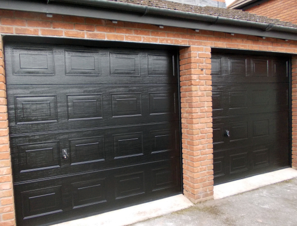 Hormann LPU40 panelled woodgrain sectional door in black