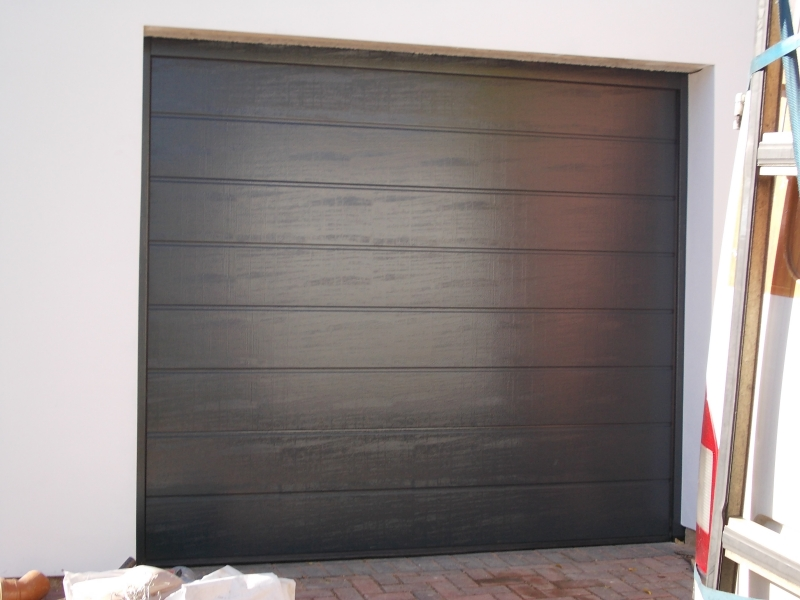 Hormann EPU40 M Ribbed steel Sectional in Anthracite Grey. Woodgrain finish
