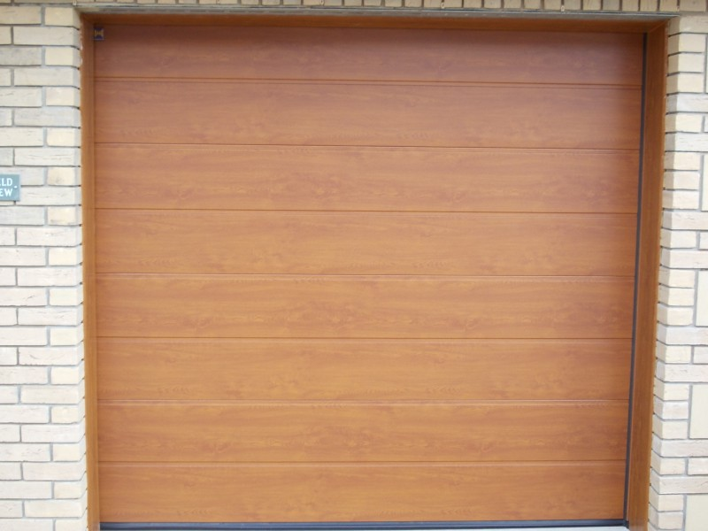 Single Hormann LPU40 M Ribbed decograin steel sectional in golden oak