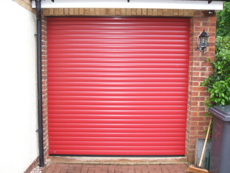 Hormann rollmatic aluminium roller garage door in red.