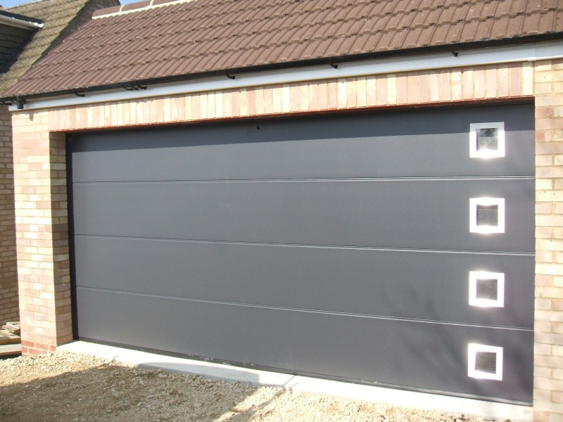Hormann LPU40 Ribbed Steel steel Sectional Garage door in Anthracite Grey with Windows