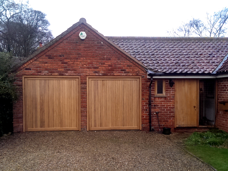 Woodrite Southam Idigbo timber doors installed inbetween twin brick garage