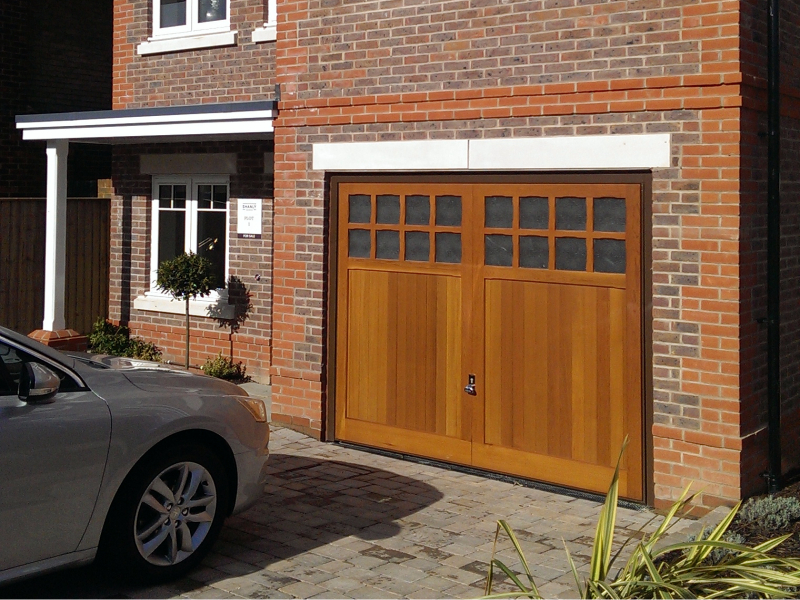 Woodrite Brandon Cedar wood timber door installed inbetween single brick garage