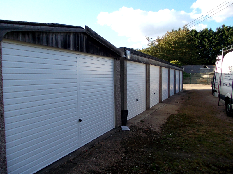 White Hormann 2002 steel up and over garage doors. Double and single size.