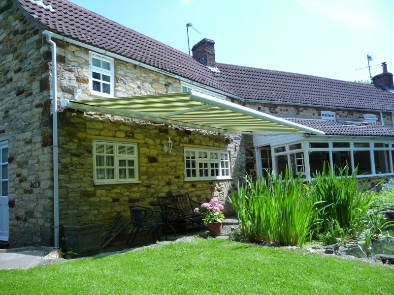 Large Green and Cream Striped Markilux 990 Patio Awning