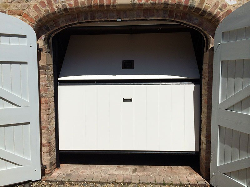 Cream Overlap Trackless Sectional Door Opening