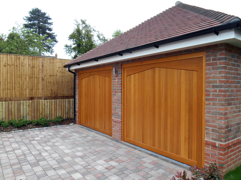 Woodrite Gawcott Cedar wood timber doors installed inbetween twin brick garage