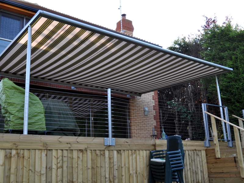 Brown and Cream striped Markilux Pergola terrace cover on decking
