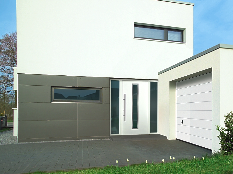thHormann ThermoPro Entrance (Style 700) Door in White (RAL 9016) with matching sectional garage door.