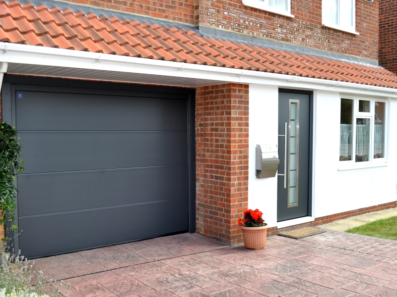 Hormann ThermoPro Entrance Door (Style 700) in Anthracite Grey (RAL 7016) with matching Sectional Garage Door.
