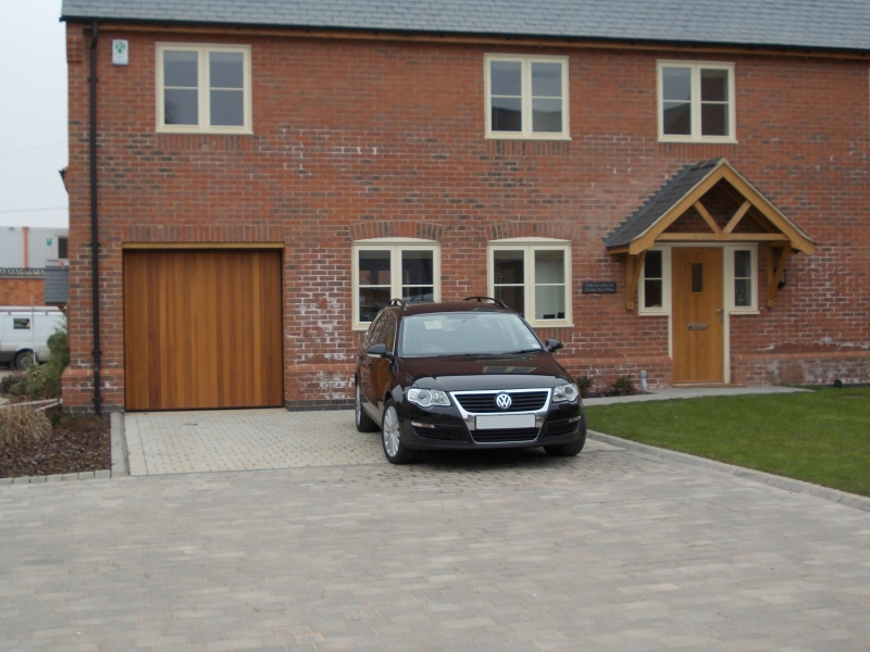 Woodrite Tingewick Cedar wood timber doors installed behind single integral brick garage