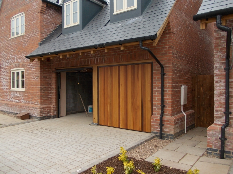 Woodrite Tingewick Cedar wood timber doors installed behind twin integral brick garage
